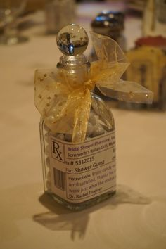 Medical-themed wedding shower gift: apothecary glass jar with white Sixlets candy and prescription label. Great thank you gift!