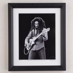 "Bob Marley performing in Dalymount, Dublin during his final world tour in 1980.  Photo is a limited edition print size 10"" x 12"" signed, numbered, stamped and framed in black box frame by the photographer Colm Henry.     Delivery  - Unless especially specified I will ship your item 1 - 3 days after payment is made.  Shipping to Ireland € 7.50  Shipping to EU €10.00  Shipping to Rest of World €12.50  Payment Method  - PayPal. (If you ..."