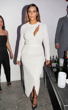 Kim parties the night away with Lindsay Lohan in a super hot winter white dress with a risqué cutout. Something that can only in Miami!