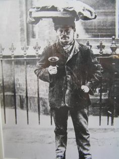 The Muffin Man. This is a street seller pictured in late Victorian times with his tray of muffins and bell for getting the attention of potential customers. Street sellers were very common in British cities.