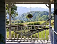 I'd kill to have a porch right now, much less a porch with a kick-ass hammock.