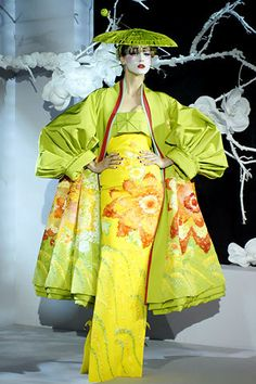 "Christian Dior Spring 2007 Couture Fashion Show inspired, according Galliano , ""by Pinkerton's affair with Cio-Cio San, Madame Butterfly""—reconfirmed his unique talent to evoke beauty, sensitivity, narrative, and emotion in a fashion show. Kimonos, obis, and geisha makeup"