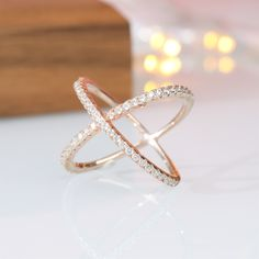 """This standard silver horizontal ring cubic zirconia wedding ring is made from 925 sterling silver and shiny white cut AAA cubic zirconia. The cross loop is one of the most popular rings of the year. The ring's exquisite sheen and simple, stylish """"X"""" design are stunning and a symbol of eternal love. Womens Wedding Bands, Wedding Ring Bands, Fashion Rings, Fashion Jewelry, Cubic Zirconia Wedding Rings, Love Knot Ring, Tungsten Mens Rings, White Topaz Rings, Engagement Bands"""