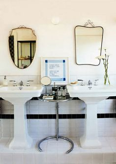 his & hers sinks with a chrome and glass cocktail table, Eileen Gray