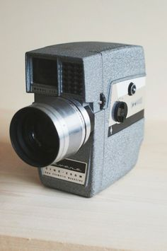 midcentury vintage movie camera. super 8 film camera. revere cine zoom model 114.