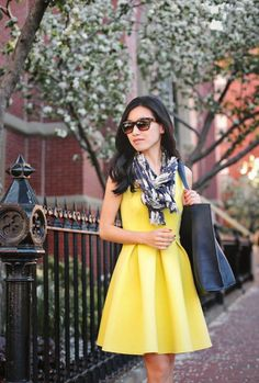 Shop this look on Lookastic:  https://lookastic.com/women/looks/yellow-skater-dress-navy-tote-bag-white-and-navy-scarf-dark-brown-sunglasses/10847  — Dark Brown Sunglasses  — White and Navy Print Scarf  — Navy Leather Tote Bag  — Yellow Skater Dress