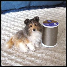fall in love with Brandy, the Shetland Sheepdog by Mary Holstad. She is hand-sewn from white and tan mohair, and has soulful glass bead eyes.
