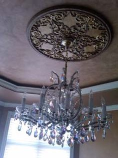 Plaster Gallery was honored to be asked to participate in designer showcase houses. Love how the Filigree Medallion works with the fixture.
