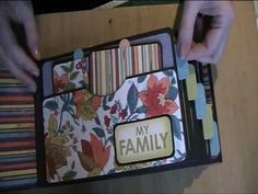 I really like this album - nice and neat, colorfull family mini album.  Don't know what language she's speaking, but it doesn't matter much unless you want the exact papers she used.