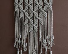 Wall panels handmade macramé technique. Material: 100% polyester. Color: gray Strap: natural wood - pine. Dimensions: The length of the strap to the bottom, including the thread - 92cm / 36,2 inches Width - 35cm / 13,8 inches