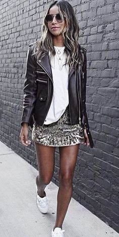 #winter #outfits white crew-neck t-shirt with black leather zip-up jacket with matching gray mini skirt outfit
