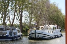 Boats cruising the Canal du Midi at Homps.