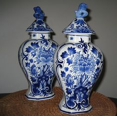 DELFT blue and white covered ginger jars with lion finials.