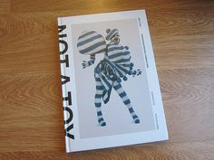 """NOT A TOY"", an exquisite book that I look at all the time for inspiration. It documents the influence of character design in contemporary art and fashion."