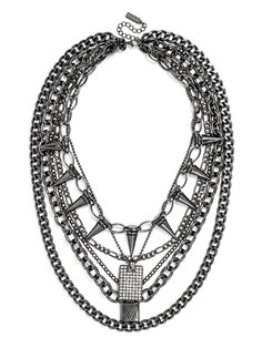 Locks, pave dog tags and spikes round out this mixed-media chain bib with plenty of edge to shake up a simple jeans-and-tee look.