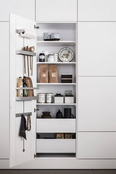 Space-Saving Idea to Steal from a High-End German Kitchen System - The Organized Home German company SieMatic is known for its sleek, high-end kitchens.) But what we're admiring on The Organized Kitchen Organisation, Kitchen Storage, Home Organization, Storage Spaces, Cottage Kitchens, Home Kitchens, Modern Kitchens, Black Kitchens, Home Theaters