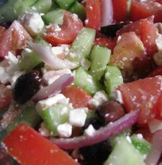 Greek salad. One of my favorites! With tomatoes, black olives, red onions, feta cheese, and cucumbers.