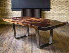 Custom dining table made of historic redwood with clear resin and antique pewter legs.