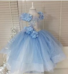 Has Elsa, Anna, and their tag-a-long crew taken over your home? If you have little girls, you might as well embrace it. What could be more fun than a frozen themed party? This eclectic couture gown is perfect for a winter in wonderland party. Get the look at #slaybambinis #slaylebrity #slaymybambini #slaynetwork #frozen #anyaandelsa #childrensfashion #kidscouture  #hautecouture #luxury #themeparty