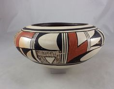 Light cream clay is hand crafted into this small bowl by famed Hopi Indian artist Paqua Naha, b.1890s-d.1955.