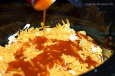 Crockpot chicken enchiladas 1 can cream of chicken soup 1 (8 oz) container sour cream 1 (4.5 oz) can chopped green chilies 2 cups cooked chicken (I had boiled chicken on hand) 2 cups corn (I used frozen) 1 (10 oz) can enchilada sauce 12 corn tortillas (cut into quarters) 2 cups shredded Cheddar cheese