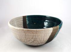 cream and green raku bowl - the dark dividing line is unglazed clay blackened during the reduction phase #1200degreesceramics.com