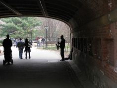 Under a random bridge in Central Park - New York City - The Jazzman - played lovely Sax music while we stood under the bridge watching him.