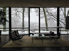 Philip Johnson's The Glass House, completed in 1949, Connecticut. The Barcelona lounge chairs, the daybed and the sofa table by Mies van der Rohe, the Diamond chairs outside by Harry Bertoia.