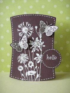 handmade card ... chocolate with white ... wonky rectangle die cut shape ... silhouette meadow flowers embossed in white with pearl centers ... die cut butterflies ... faux stitching ... great card!!