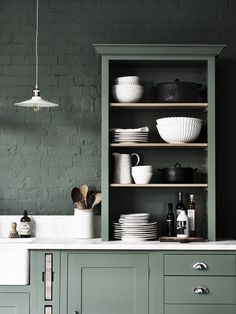 Suffolk kitchen hand-painted in Cactus. Walls painted in Cactus by Neptune. We ♥ green interiors.