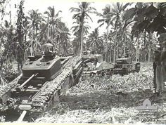 "Churchills at Madang-2 Official caption: ""MADANG, NEW GUINEA. 1944-10. A Churchill VII tank being assisted from a bog by a Sherman M4A2 medium tank and another Churchill VII tank during tests conducted at HQ 4 Armoured Brigade."" All these tanks were provided by the British Army."