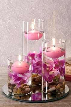 Set Of Three Lilac Floating Candles Set of 3 decorative glasses filled with lilac pebbles, artificial flowers and floating *ALL WHITE* candles all on a mirrored base. Tallest glass is Base diam. Floating Candle Centerpieces, Diy Candles, Ideas Candles, Fishbowl Centerpiece, Chandelier Centerpiece, Hanging Candles, White Candles, Mason Jar Crafts, Mason Jar Diy