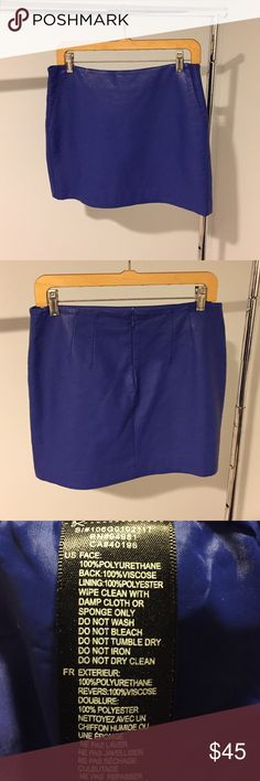 """Pretty Blue Mini Pretty Blue Color is perfect for a night out. Size Large but fits like a Medium. Length 14 1/2"""". Two pockets in front.  Vegan Leather.  NWOT. Never worn. Skirts Mini"""