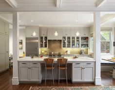 island with beams, traditional kitchen by Gast Architects