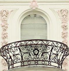 Paris, Prada, Pearls, Perfume. Wrought-iron balcony...