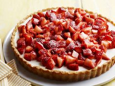 Food Network invites you to try this Strawberries-and-Cream Tart recipe.