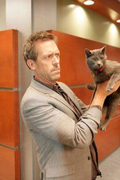 """Hugh Laurie """"House"""" and a cat. :)"""