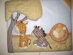 Handmade Baby Room Wall Hanging, Theme was Giraffe. Materials include: Foam board, batting, various fabrics, ribbon and time.