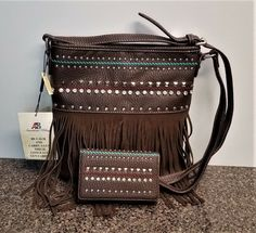 Made of top quality faux leather, this crossbody bag with matching wallet features Fringe design on the front. Matching wallet features Inside of bag include a zippered pocket and 2 open pockets. Concealed Carry Purse, Fringe Crossbody Bag, Unique Purses, Long Wallet, Cross Body Handbags, Leather Men, Leather Purses, Montana, Country