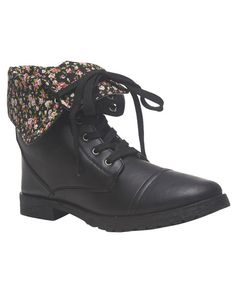 """With style inside and out, this faux leather combat boot is the  perfect casual go-to shoe. The boot features a shaft that can be folded over to reveal a pretty floral print interior. The shaft, when upright, has decorative snap tabs at the cuff edge. Its lace-up  structure with metal eyelets adds even more style, including its round  toe and chunky heel.      Upright shaft: 6"""" height / Heel: 1"""" height     Man Made Materials / Metal     ..."""