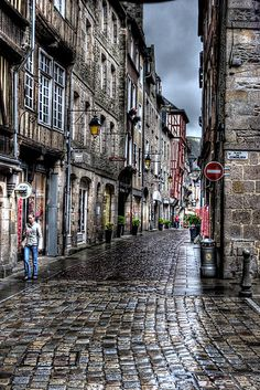 Cobblestone street in Dinan, Brittany, France.  Place des Cordeliers by latitude54photo.