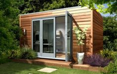 Garden offices and studio - Modern/Cube - GBP 19,995.00 [ Visit Store » ]  This cube has style in its simplicity. It has large doors to let in the light so you don't feel cooped up in a small structure and I love the wood siding for a natural feel.