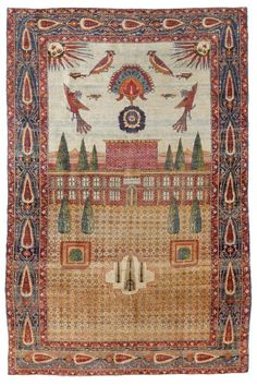 KIRMAN PICTORIAL CARPET, SILK antique.Attractive collector's item in good condition. Depiction of a garden landscape with a palace, the sky full of birds, blue edging patterned with cedars, 125x176 cm. Depicted in the catalogue of the Biennale 1992, page 413.