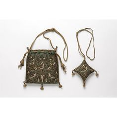 Bag, English, 1625-1650; Victoria & Albert Museum No. T.51&A-1954; Flat and square bag and separate pin cushion of blue silk satin hand-embroidered on both sides in a pattern of birds and flowers with silver and silver-gilt thread, metal purl and freshwater pearls. The bag is lined with brown silk. The bag and pin cushion are trimmed with flat braid and finials of beige silk and silver thread. Draw-sting of silk braid. Padded.