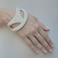 futuristic hospital bracelet- tracks your vitals. Very cool wearable technology