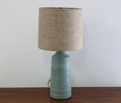 """Hand thrown stoneware with custom burlap shade and bronze finial. Hand carved. Finished height 21"""""""