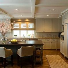 Phoebe Howard - kitchens - coffered ceiling, light gray, kitchen cabinets, granite, countertops, dark gray, kitchen island, turned legs, soapstone, countertops, slipcover, counter stools, tan cabinets, tan kitchen cabinets,