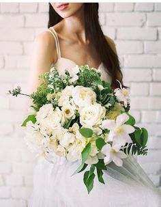 White, yellow, and green bouquet by Remi & Gold