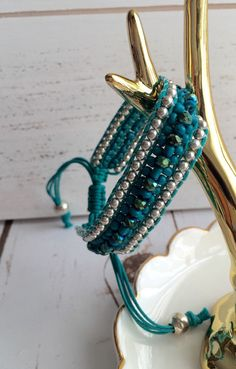 A personal favorite from my Etsy shop https://www.etsy.com/listing/275529704/beautiful-teal-crystal-bracelet-teal-and
