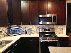 Kitchen Remodel by M.A.K. Construction Services- Craftsman Java Maple Wood Cabinets, Stainless Steel Appliances, Backsplash- Glass Subway Tile, Silestone Countertop